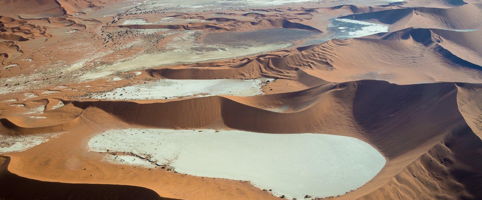 Climb the towering orange sand dunes
