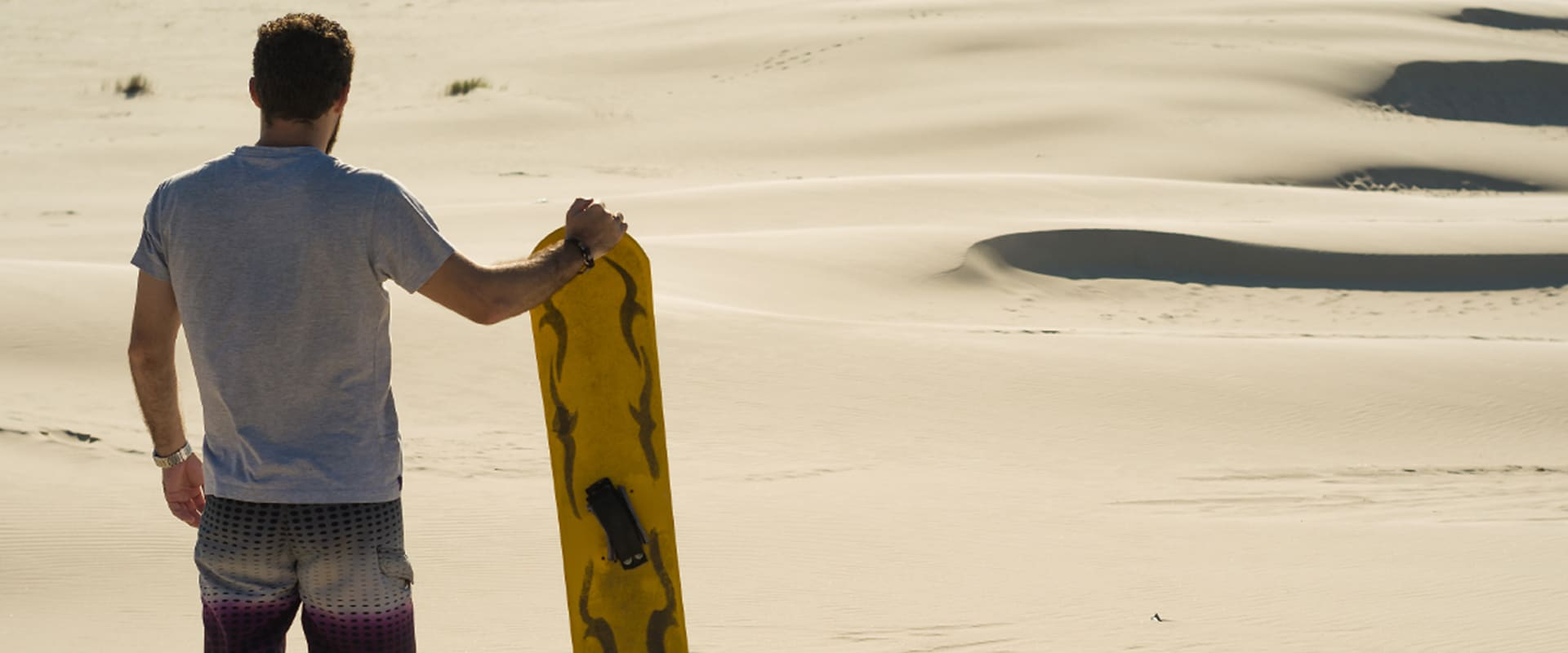 Sand-boarding down the dunes