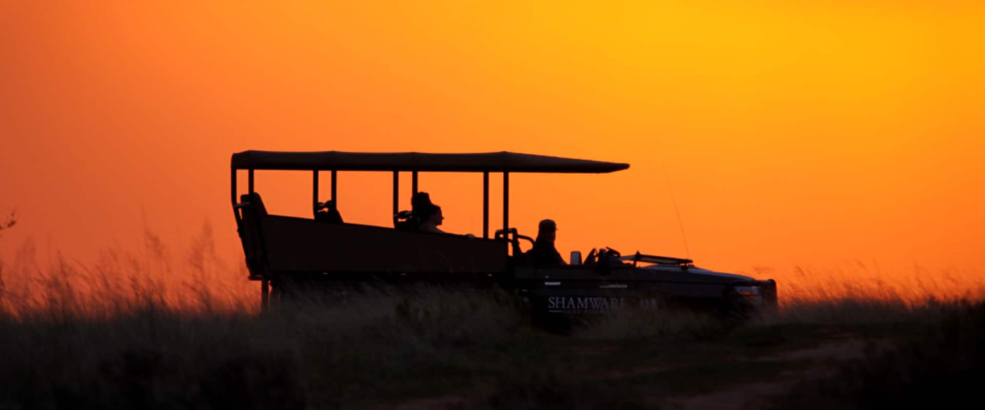 Drink sundowners on a sunset game drive
