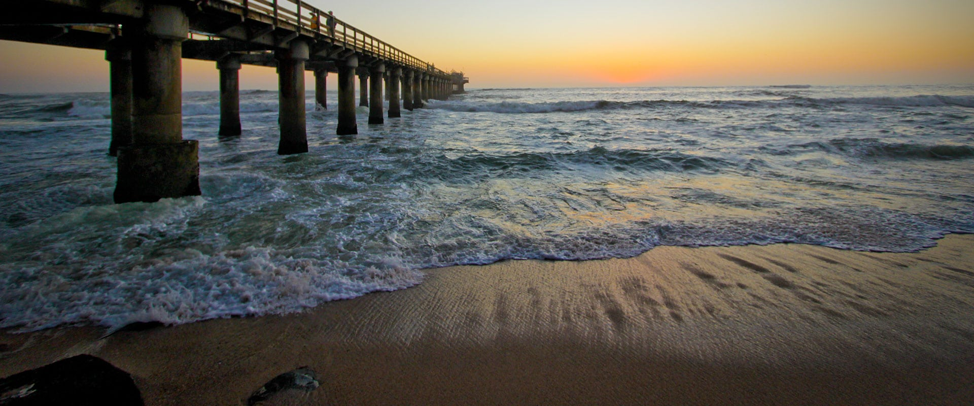 Sip sundowners on the historical jetty
