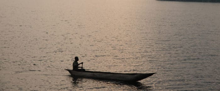 A canoe at sunset on a lake in the Democratic Republic of Congo